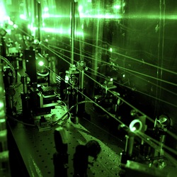 Laser spectroscopy to see the proton size. A complex laser system is needed to perform the muonic hydrogen experiment. The picture shows frequency doubling optics transforming infrared to green light.