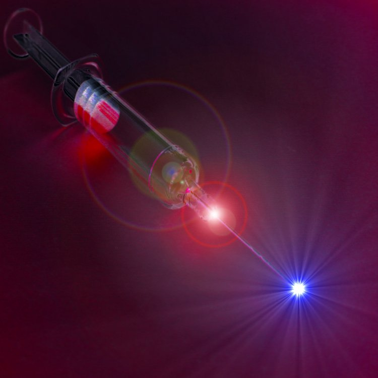 An artistic view of a light syringe. Energetic laser pulses may soon become a painless means to administer drugs directly into tissues.