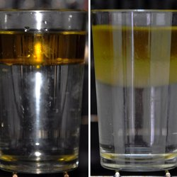 Oil-water Illustration of spin gradient thermometry. At low temperatures, oil and water do not mix and form clearly separated phases with a tiny interface (left). At higher temperatures, the interface region is considerably larger, allowing one to deduce the temperature of the fluids (right).